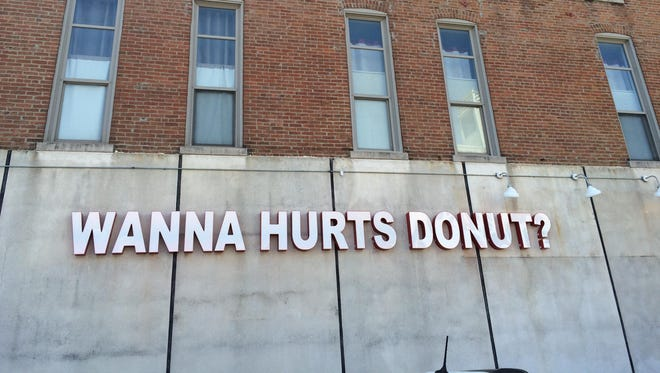 Hurts Donut installed a big sign on the east side of its new building at 320 Park Central East.