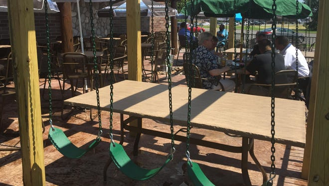 Boulder Tap House added a new patio Tuesday that includes tables with swing seats.