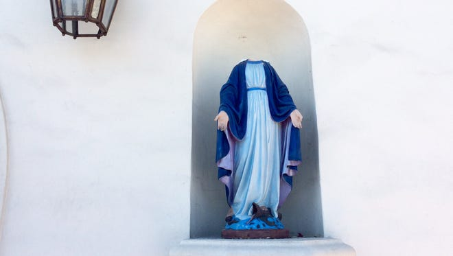 A statue of the Virgin Mary was beheaded at Our Lady of Solitude Church in Palm Springs Thursday.