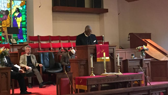 Rev. Gregory Robeson Smith speaks at Mount Hope A.M.E. Zion Church in White Plains for an interfaith prayer service honoring the victims of the shooting in Charleston, S.C.