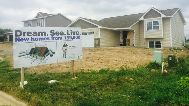 Denyon Homes took over the Ridgeview Subdivision in Weston two years ago. It plans to build on long-undeveloped lots. The edge of the neighborhood is seen on Friday July 24, 2015.