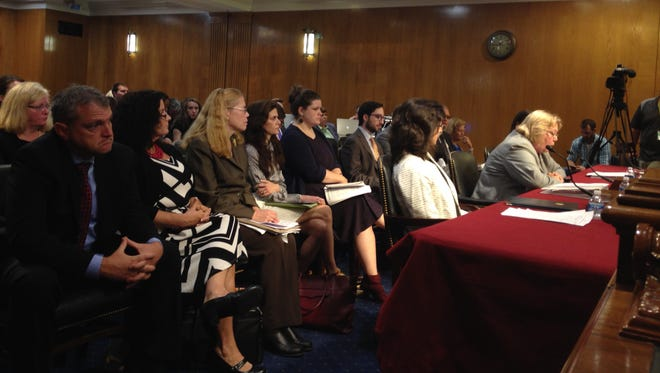 Whistleblowers listen to VA Deputy Inspector General Linda Halliday testify on Capitol Hill Thursday. From left, social worker Shea Wilkes of Shreveport, La.; social worker Germaine Clarno of Hines, Ill.; Dr. Katherine Mitchell of Phoenix; and cardiologist Dr. Lisa Nee of Hines, Ill.