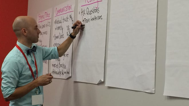 Daniel Hoffman-Zinnel, director of education and leadership at Planned Parenthood of the Heartland, leads a workshop on health issues. He was named the new executive director of One Iowa on Friday, Nov. 18, 2016.