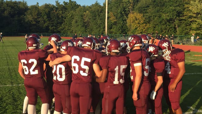 The New Paltz High School football team in the huddle before its game with Highland on Friday.