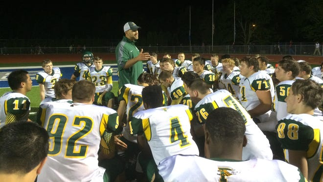 Green Bay Preble football coach Tim Larsen talks to his players following a 28-25 victory at Green Bay Southwest Friday.