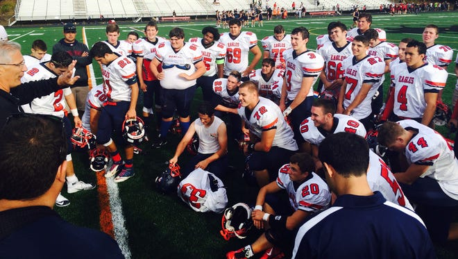 Al DePippo, whose son, Nick, a former Eastchester High School football player, died in June at just 23, speaks to the Eagles after their 32-7 win at Sleepy Hollow on Sept. 26, 2015.
