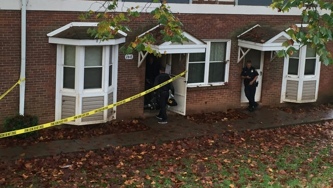 A team of forensics officers on Wednesday morning investigate the scene of a fatal shooting at Pisgah View Tuesday night.