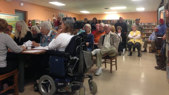 Members of the public look on as the Eastern Shore Public Library Board of Trustees ponders plans for a new main library at a meeting Monday, Nov. 2, 2015 in Accomac, Virginia.
