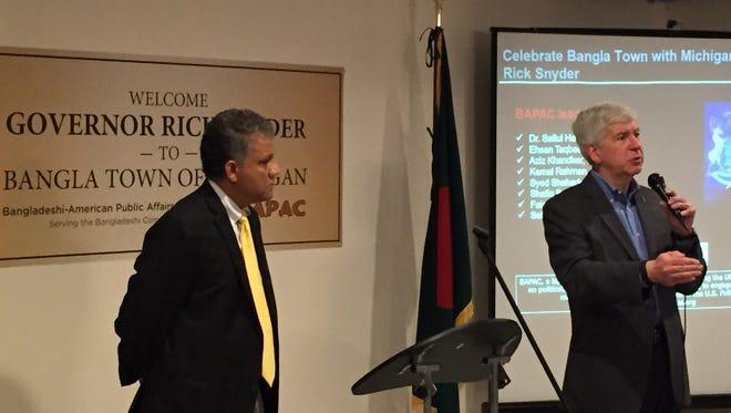 Gov. Rick Snyder speaks to Bangladeshi Americans about BanglaTown at the Bangladeshi American Public Affairs Committee (BAPAC) in Hamtramck on Nov. 6, 2015. Ehsan Taqbee, founding chair of BAPAC, listens.