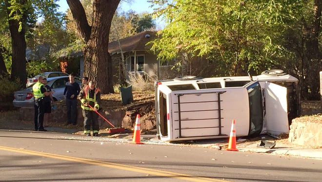 A Jeep flipped onto its side Saturday, Nov. 14, 2014, in a northwest Fort Collins residential area.