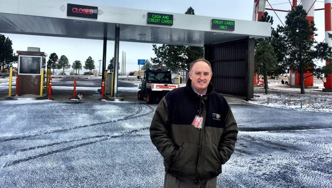"Great Falls Airport Director John Faulkner says the airport's new ""toll plaza"" by the water tower will allow folks traveling during the busy holiday season to exit parking more quickly."