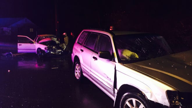Two people were trapped in their vehicles after a crash Monday night in Glassboro.