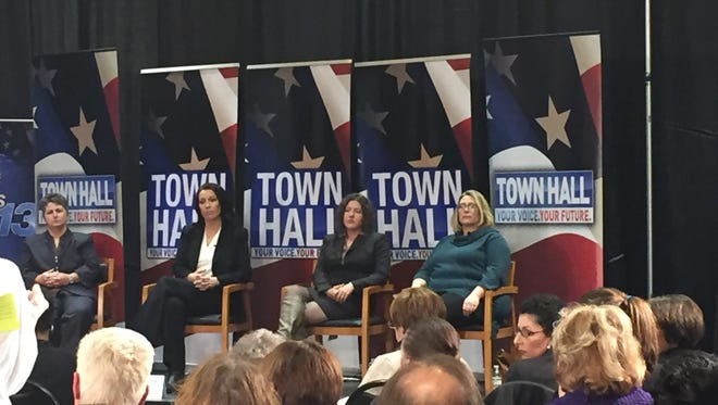 Panelists speak at a forum Thursday night hosted by WLOS, from left April Burgess-Johnson, executive director of Helpmate, Sgt. Dottie Parker of the Henderson County Sheriff's Office, Julie Klipp Nicholson, coordinator of the Family Justice Center, and domestic violence survivor Sara Hardesty.
