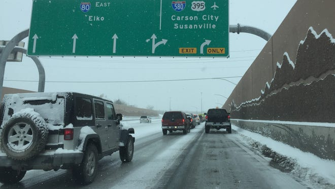 File photo: Traffic moves slowly on eastbound Interstate 80 the morning of Dec. 24, 2015 in Reno.