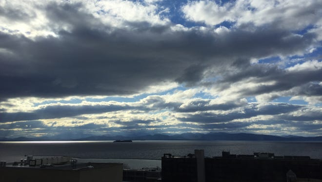 Warm winds buffet clouds above Lake Champlain on Thursday west of Burlington.