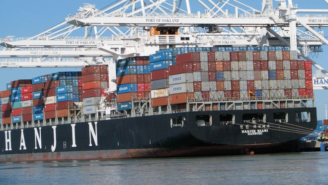 A container ship is loaded at California's Port of Oakland.