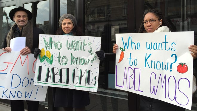 Protesters outside New York Assemblyman Gary Pretlow's Mount Vernon office on Feb. 10. The protesters want Pretlow to co-sponsor a proposed law that would require the labeling of genetically modified foods.