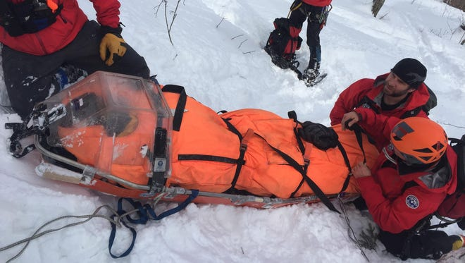 Marcus Wadlington is packaged into a litter in preparation for extraction after an accident while skiing on Jan. 20.