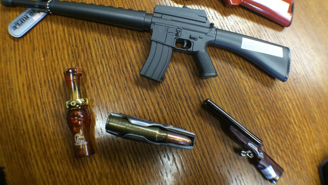 A few of the novelty lighters from Pittsville Fire Chief Jerry Minor's collection. There's been a growing trend of lighters in the shape of guns, Minor said.