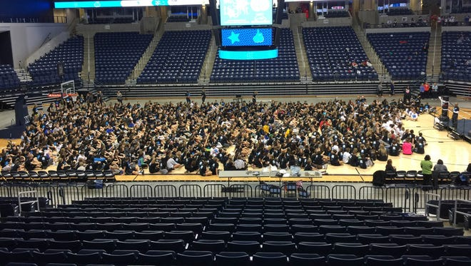 "About 1,000 area high school students attended ""Night for the Fight,"" a pediatric cancer research event held at Cintas Center at the Xavier University campus. Event organizers said they're hoping to surpass their $100,000 fundraising goal."