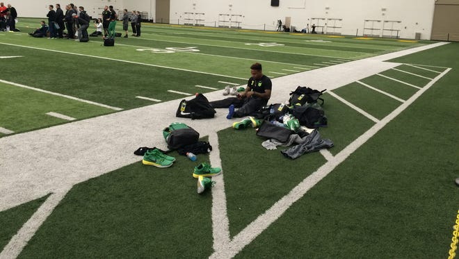 Former Oregon quarterback Vernon Adams takes a moment to watch other Ducks take part in drills Thursday at pro day.