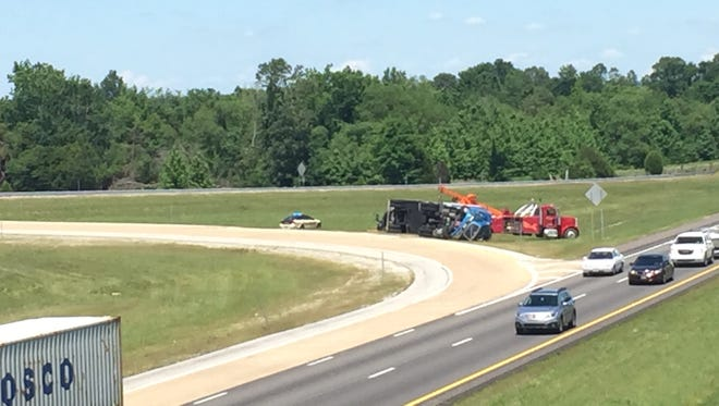 The Tennessee Highway Patrol responded this afternoon when a tractor-trailer overturned on the westbound Interstate 40 on-ramp at Exit 76.