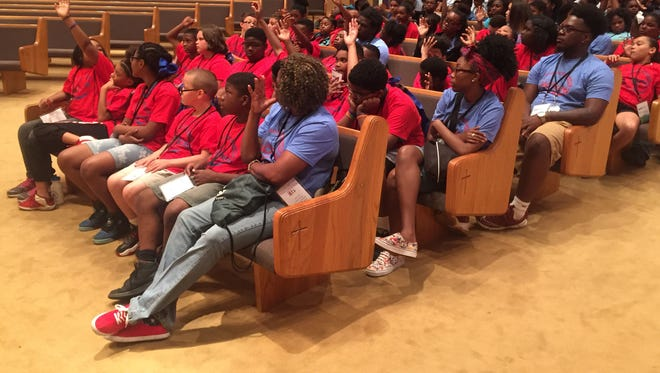 Students respond Thursday to a question about social media posed by Lt. Byron Taylor of the Jackson Police Department during the first annual Youth Health TennCare Kids conference.
