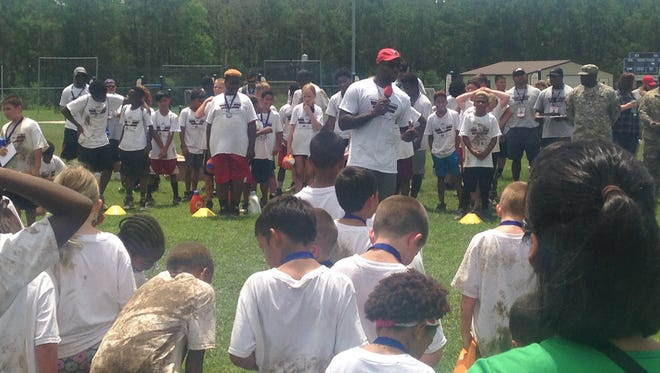 Arizona Cardinals defensive back and former LSU Tiger Patrick Peterson talks to campers Tuesday at Perez Field.