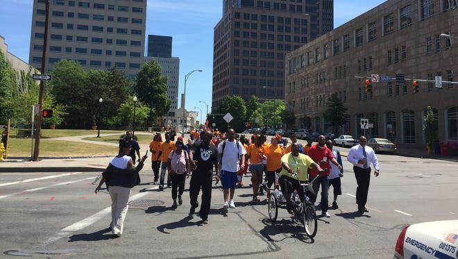 """The """"Stop the Violence"""" march heads toward City Hall on June 18."""