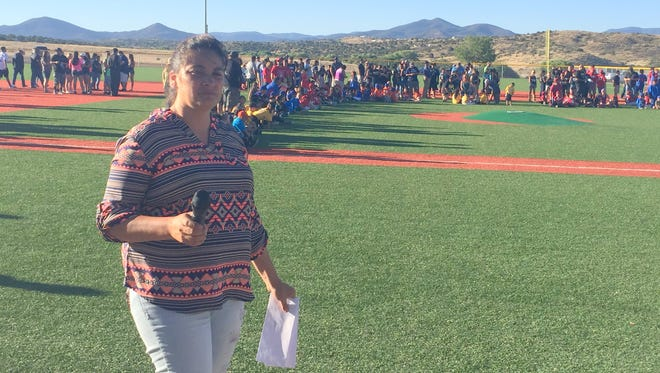 Silver City Little League president Amanda Martinez prepares to announce All-Stars during closing ceremonies.