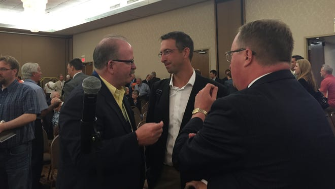 Jason Glodt, center, discusses the South Dakota Bar Association's decision to oppose Marsy's Law, the constitutional amendment he sponsored, with Jackson County State's Attorney Daniel Van Gorp.