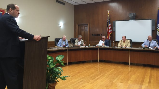 Ouachita Parish Schools personnel director Todd Guice talks to the board about hearing offices for employee discipline issues.