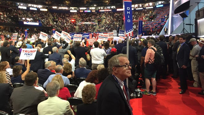 Ohio Attorney General Mike DeWine, front, is on the floor of the convention Wednesday night as vice presidential candidate Mike Pence speaks. DeWine, who is positioning himself for a run at Ohio governor, had a good week at the convention.