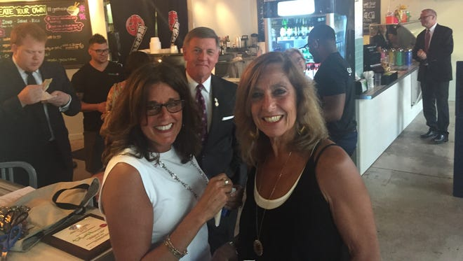 City Councilwoman Elaine Spaull, right, and state Sen. Rich Funke, middle, at the opening of new Plum House Cafe