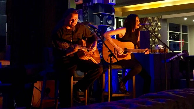 """Esjay Jones (right) and Brenden Boerger (left) perform at the Hard Rock Hotel in Palm Springs on July 22, 2016 as a part of """"Esjay and Friends,"""" a free acoustic music event every Friday night."""