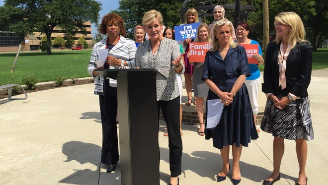 U.S. Rep. Brenda Lawrence, former Gov. Jennifer Granholm, U.S. Rep. Debbie Dingell and Texas Sen. Wendy Davis celebrate Women's Equality Day in Detroit.