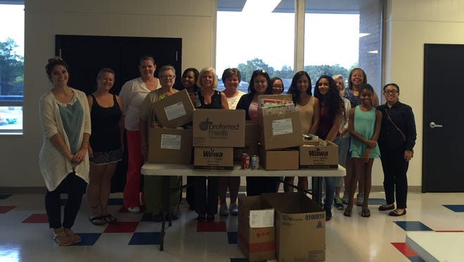 Volunteers from the YMCA of Vineland and Sun Bank recently gathered almost 350 pounds of nonperishable food for the Impact Harvest food bank.
