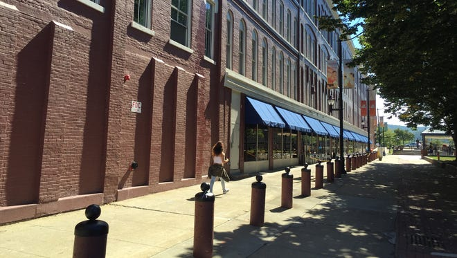 Though it created only a handful of jobs, economic developers say the $100,000 in annual tax breaks for the Chenango Commons brings a long-vacant department store back to life with residential and retail development.