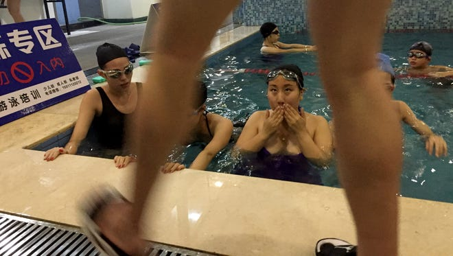 Feng Sihan and others learn to swim at Shenshi Yangguang swmming pool in downtown Beijing.
