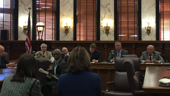 A special panel of lawmakers looking for ways to cut state spending grills agency heads on Tuesday about contracts and consultants.