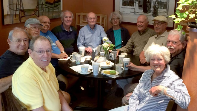 """Clockwise from left, Dennis Ritter, Bob McGowan, Dale Bond, Mel Vaara, Judge Gerald """"Jerry"""" McNally, Bill Haney, Carole Cotter Bodner, Jim Reed, Wally Niezguski, Floyd """"Buck"""" Kopietz and Gail Reading. They are seated at the table at Brioni Cafe & Deli where they meet at 9 a.m. every Monday. The picture was taken in July 2016."""