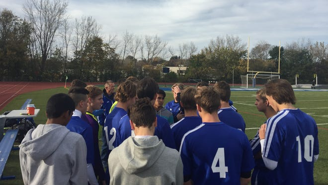 The Millbrook boys soccer team huddles during its Section 9 Class C final against S.S. Seward.
