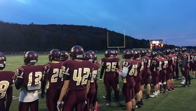 The Arlington football team preps for its Section 1 Class AA semifinal against Scarsdale. Oct. 29, 2016.