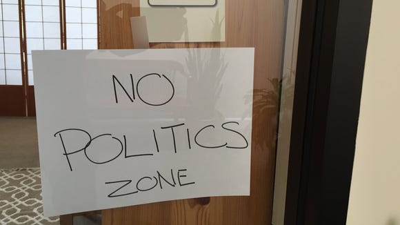 This sign on an office expresses the sentiments of many during an election that psychologists say is causing anxiety among many people.