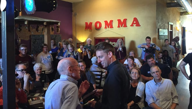 Jason Kander meets with a supporter during a rally on Tuesday, Nov. 1, 2016, at Big Momma's Coffee and Espresso Bar in Springfield.