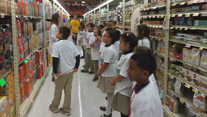 Students from Compass Academy Charter School in Vineland learn about making healthy choices from a ShopRite dietitian during a visit to the store.