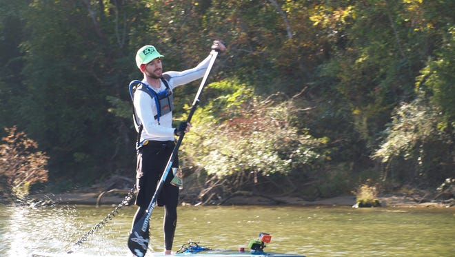 Matt Kearney ompeting in the 12-foot-6 stand-up division, finished third in the 31-mile ChattaJack paddleboard race down the Tennessee River in October.