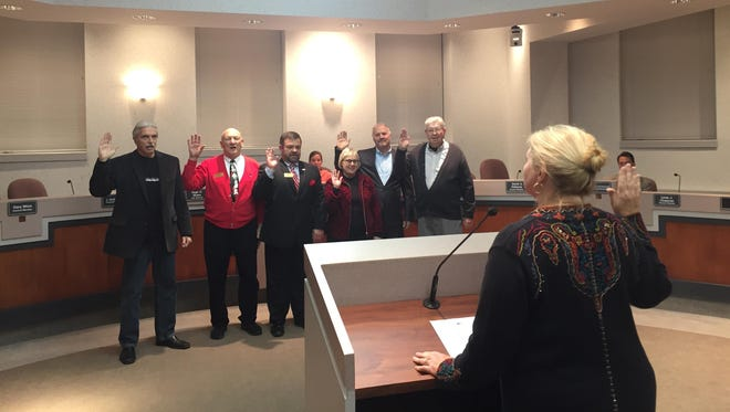 Gary Winn, Mel Carroll, Kelly Huff, Julie Metzger-Aubuchon, Duane Froelicher and David Osborne are sworn in as Florence City Council members by Mayor Diane Whalen at a council meeting on Dec. 6, 2016.