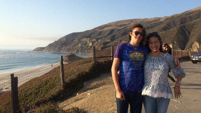 Luke Smith with his mother on the California coast.