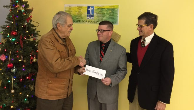Frank Dixon, chairman emeritus, and Bob Phillips, vice chairman of the Francis J. Dixon Foundation, present a check in the amount of $10,000 to Troy E. Williams, executive director of Lebanon County Christian Ministries.